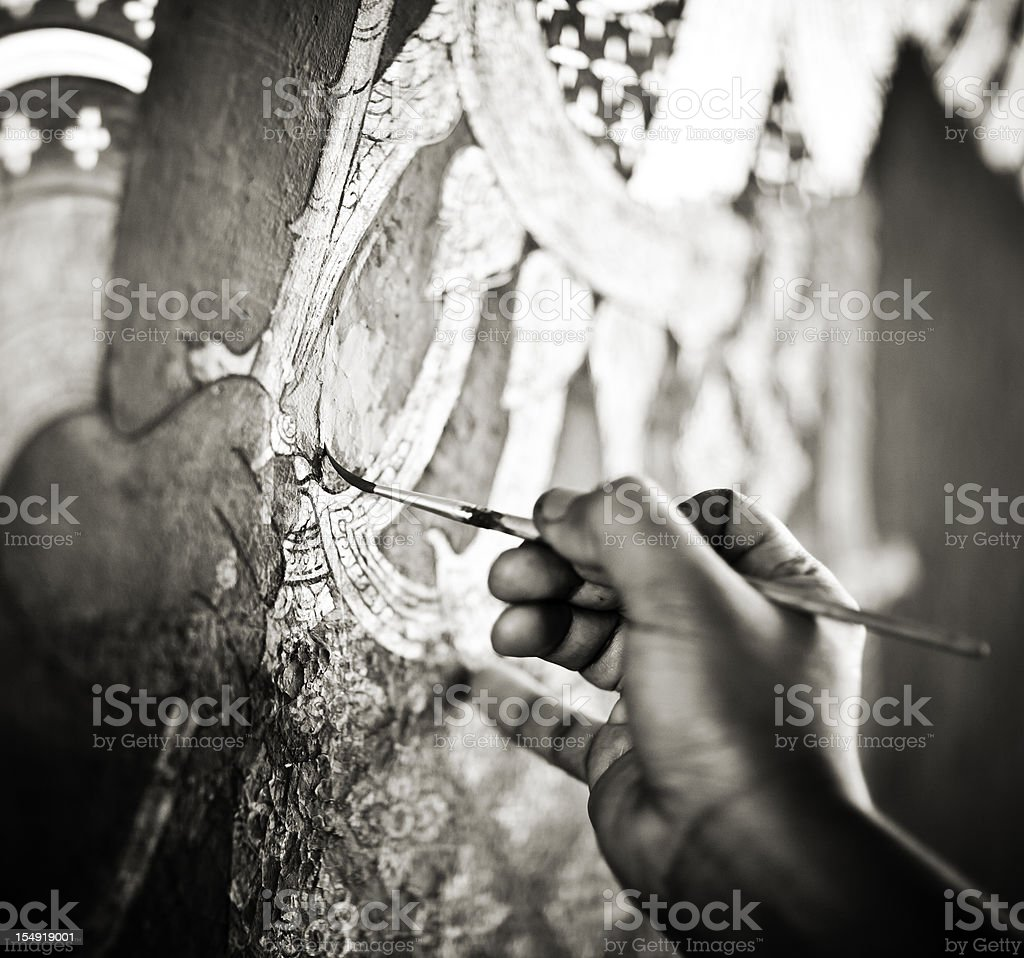 Artist Restoring a Painting in the Grand Palace stock photo