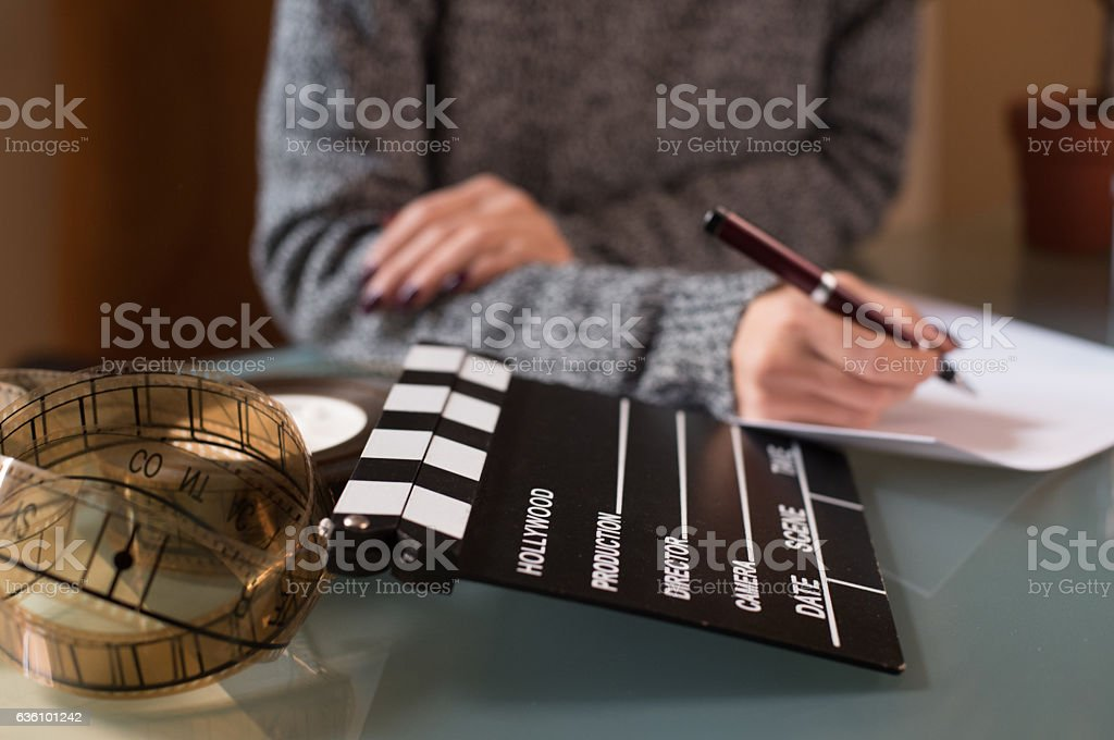 Artist screenwriter desktop detail clapper board stock photo
