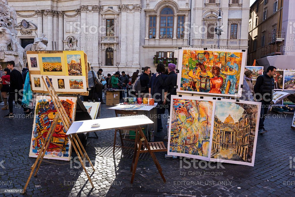 Artist selling paintings on Piazza Navona in Rome stock photo
