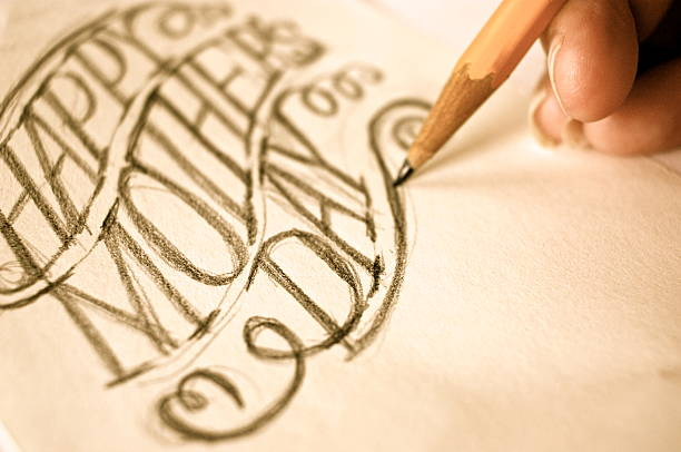 artist sketching hand lettering happy mothers day - happy mothers day type stock photos and pictures