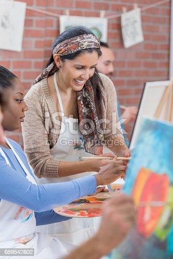 658645980 istock photo Artist teaches painting in art studio 659542602