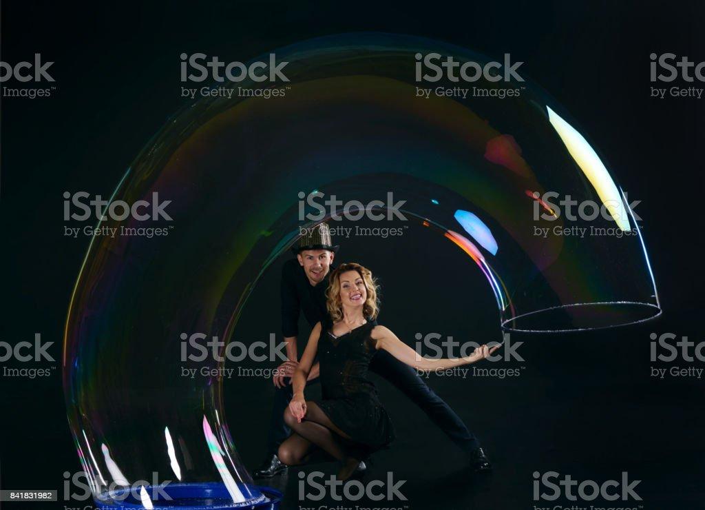 Artist team make amusement soap bubble. Soap bubble show in black studio. stock photo