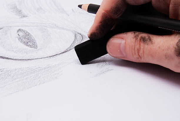 artist using charcoals drawing a cat's eye. - charcoal drawing stock photos and pictures