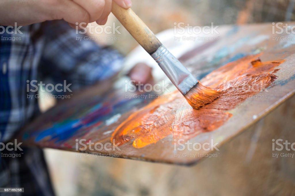 artist using drawing brushes. stock photo