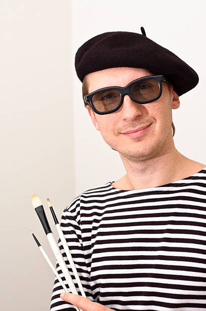Artist wearing sunglasses and a beret with three brushes French artist in beret with three brushes beret stock pictures, royalty-free photos & images