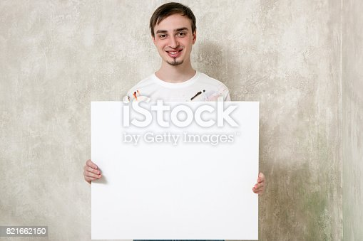 istock Artist with blank picture 821662150