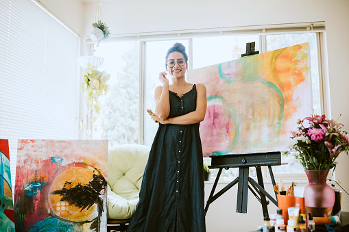 istock Artist Woman Painting In Home Studio 1169924379