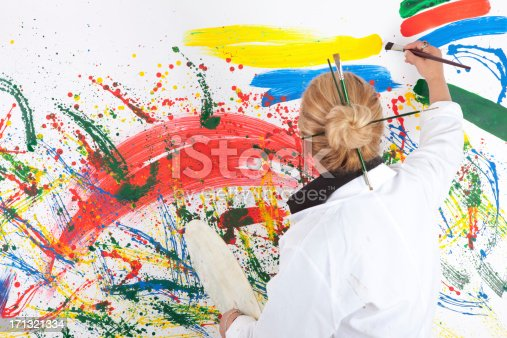 istock Artist woman standing before painting 171321334