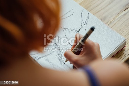 Artist working at coffee shop