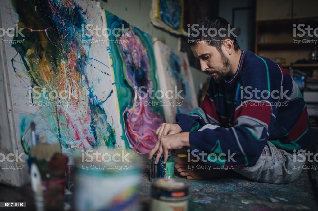 Artist working in studio stock photo
