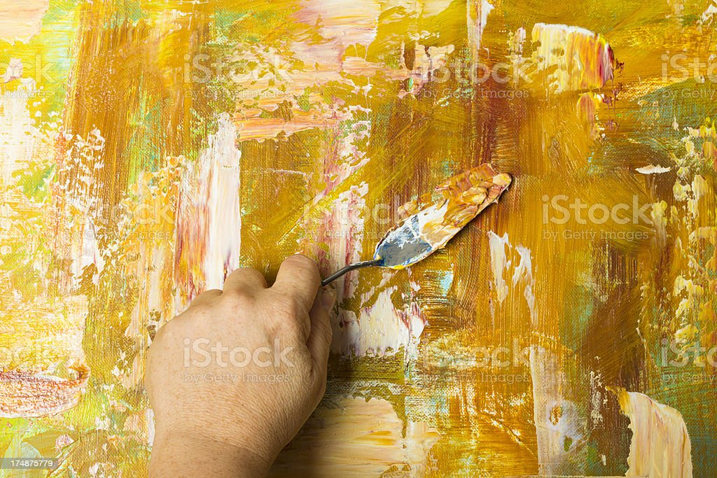 Artist Working On A Palette Knife Painting royalty-free stock photo