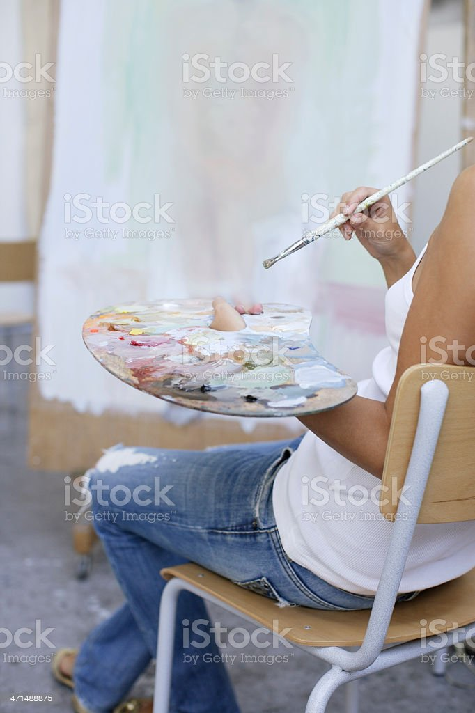 artist working on painting royalty-free stock photo