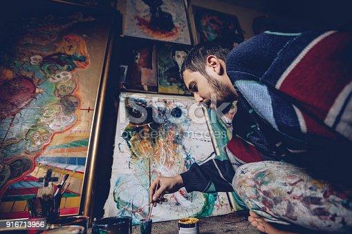 865169666 istock photo Artist working on painting 916713956