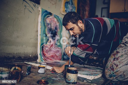 865169666 istock photo Artist working with colors 893262420
