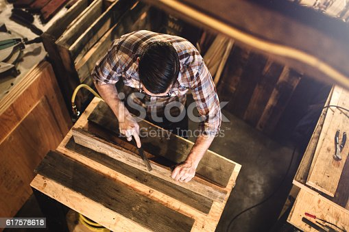 istock Artist Working With Wood in Studio 617578618