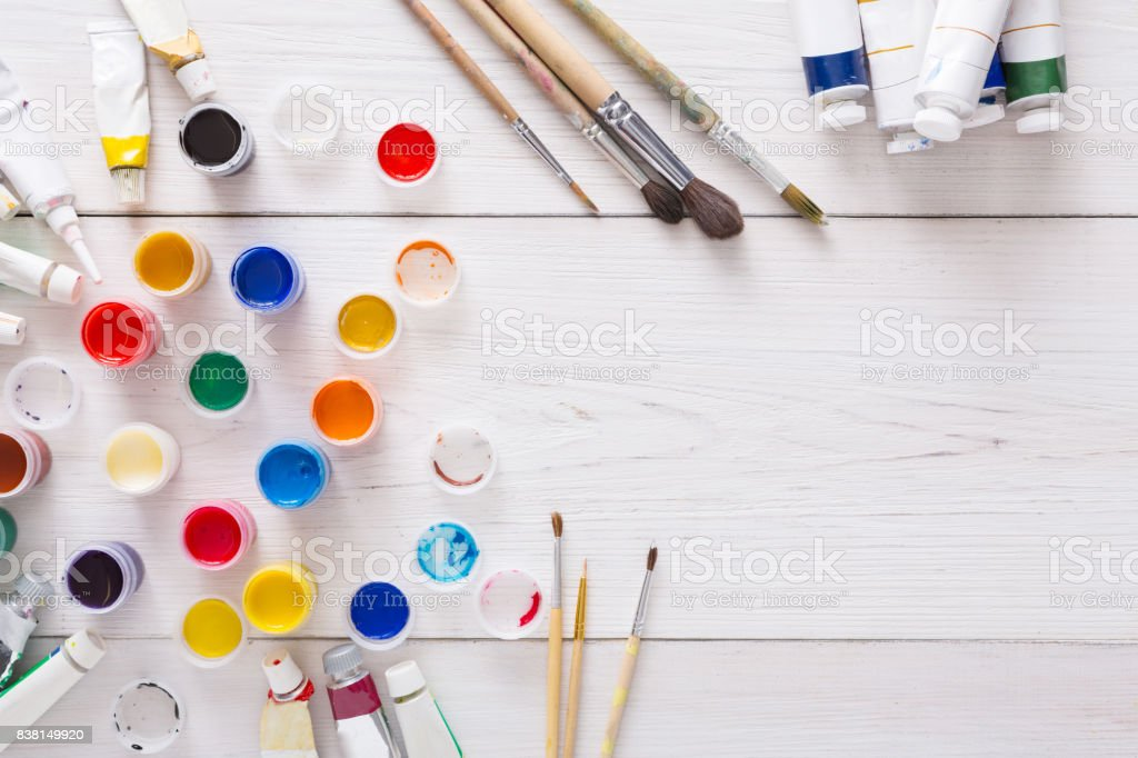 Artist workplace, set of color paints on wood desk stock photo