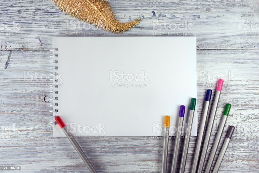 Artist workspace. Drawing tools, stationary supplies, workplace of artist. blank paper on white wooden desk, top view, flat lay, copy space stock photo