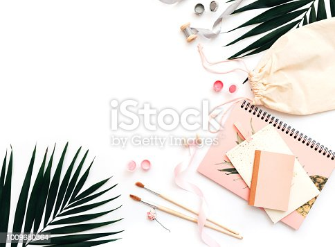 istock Artist workspace. Watercolor paintings with fdecorations. Flat lay, top view 1009680364