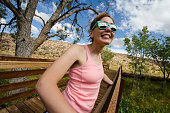 Artistic angle of a young woman tourist enjoying the scenery at Red Rock Canyon National Conservation Area
