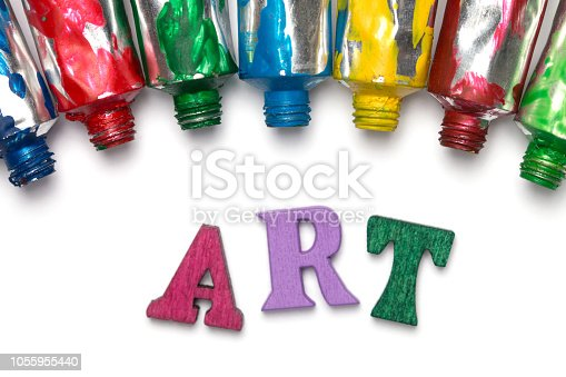istock Artistic background. Acrylic colourful paint tubes isolated on white background with copy space. Cut out. 1055955440