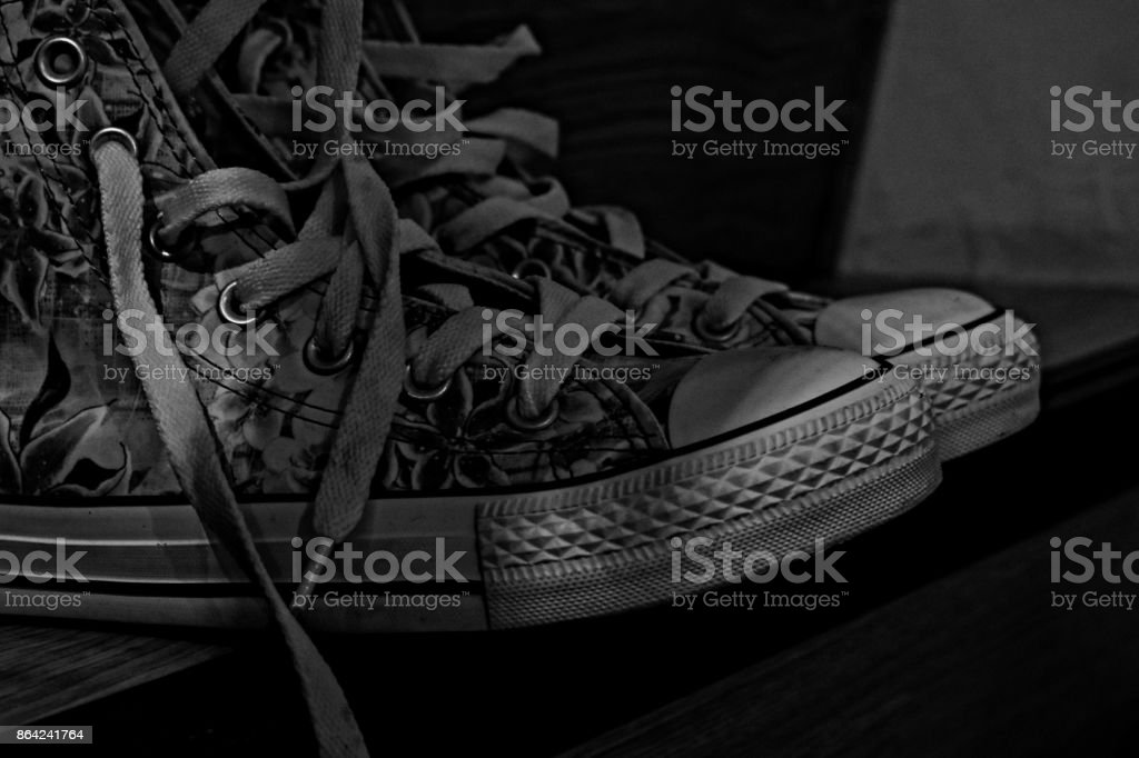 Artistic black and white image of rugged shoes royalty-free stock photo