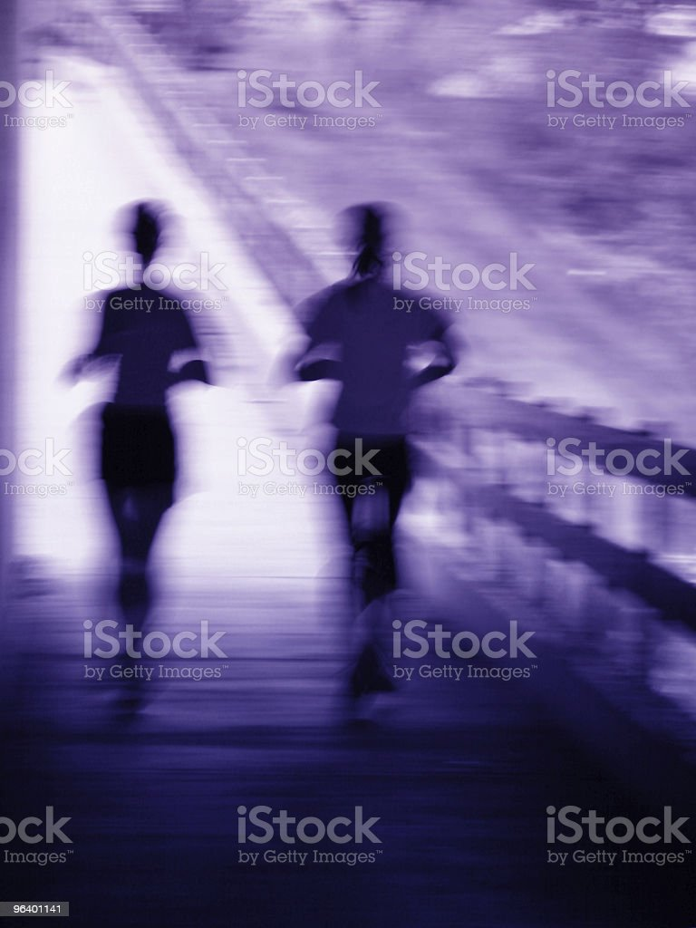 Artistic blur of a running couple - Royalty-free Adult Stock Photo