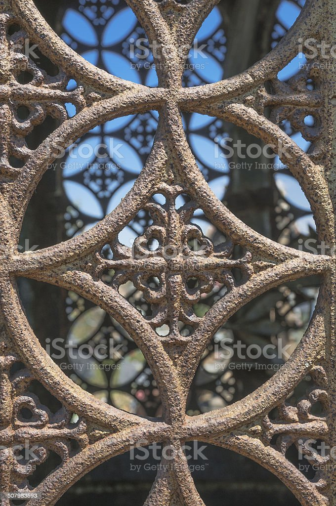 Artistic cast iron grille in the old chapel royalty-free stock photo