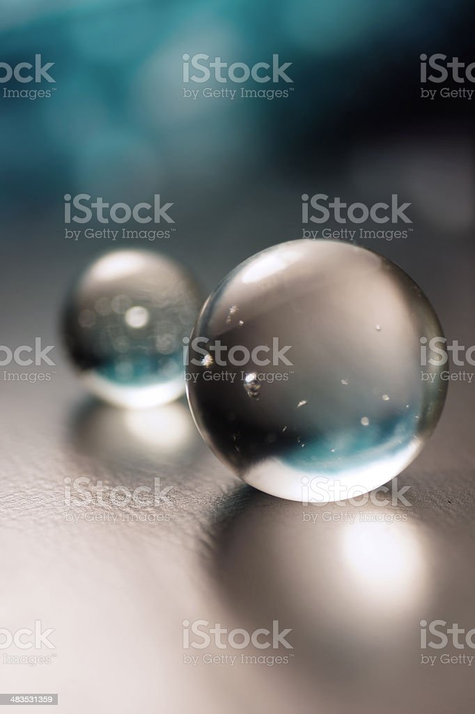 Artistic composition of clear glass ball (crystal sphere) stock photo