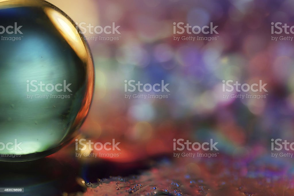 Artistic composition of colorful glass ball on dvd stock photo