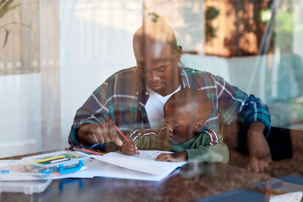 Artistic dad with young child at home stock photo