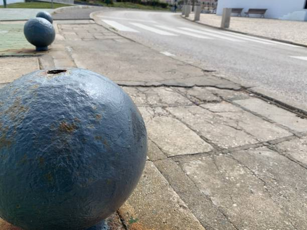 Artistic display of metal spheres on pavement stock photo