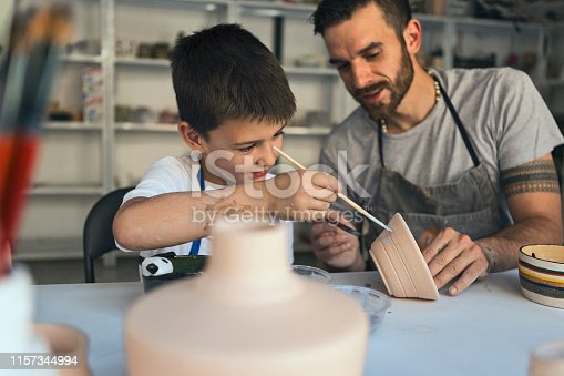 Father and son working on art