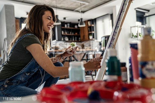 937313030 istock photo Artistic girl mixing colors for painting 1151678392
