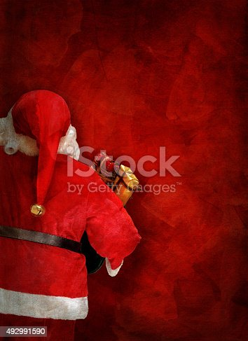 istock Artistic greeting card or poster design with Santa Claus doll 492991590