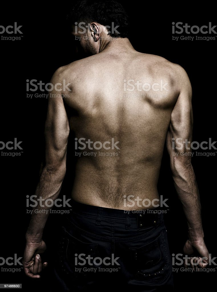 Artistic grunge image of man with muscular back royalty-free stock photo