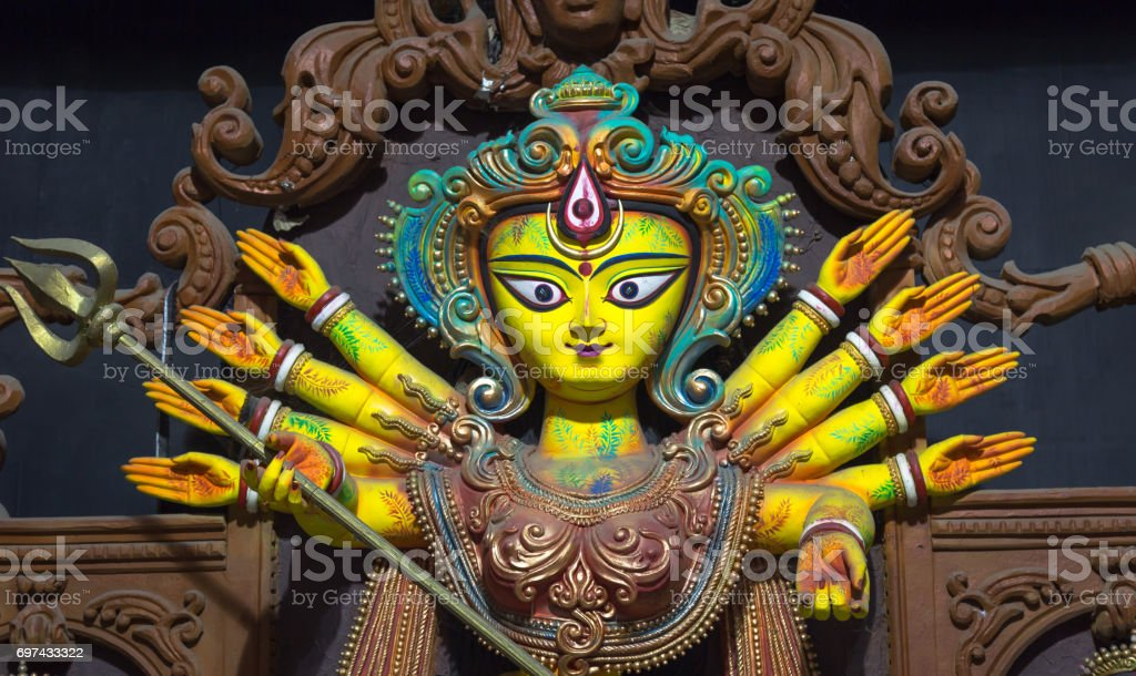 Artistic Hindu goddess Durga idol created from clay and teracotta. stock photo