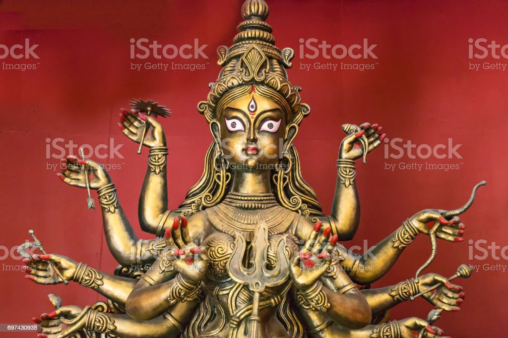 Artistic Hindu goddess Durga idol created from terracotta. stock photo