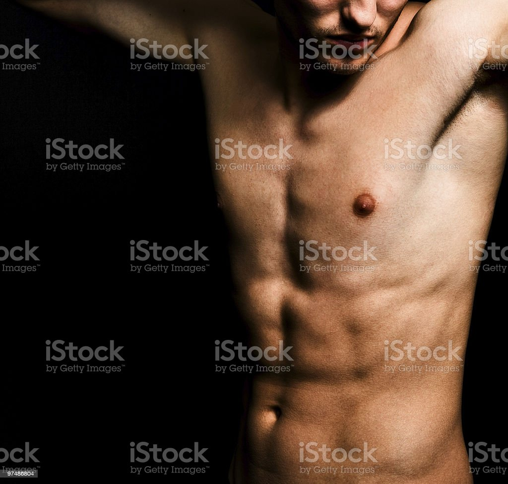 Artistic image of muscular sexy man body royalty-free stock photo