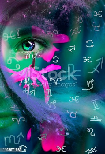 istock Artistic portrait of a female face and astrological symbols 1198571565