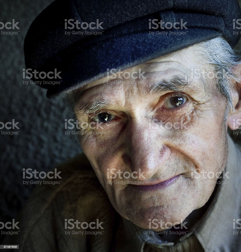 Artistic portrait of friendly senior old man royalty-free stock photo