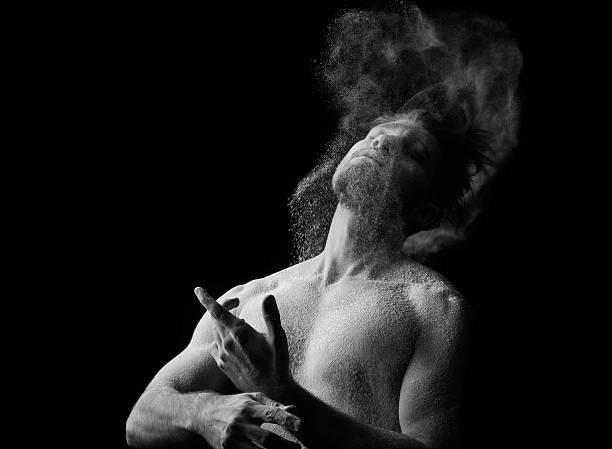Artistic portrait of man in motion with powder splash - Photo
