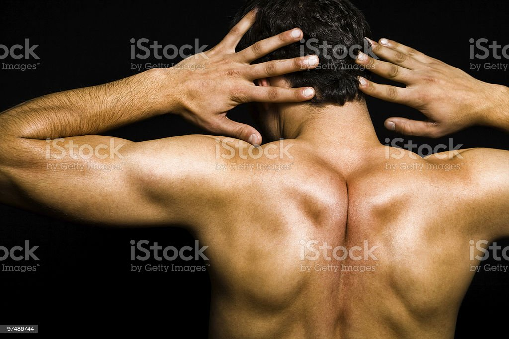 Artistic pose - back of muscular man royalty-free stock photo