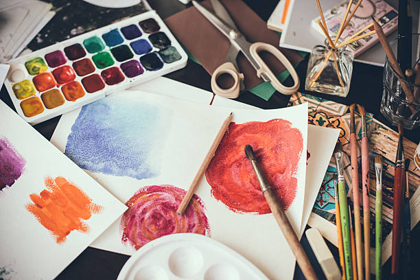 Artistic studio Mess in the the artist's studio, watercolor paints, brushes and sketches, palette and painting tools. Designer's working place, hipster style. hobbies stock pictures, royalty-free photos & images