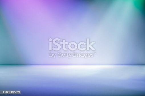 Artistic studio wall background with spotlights in gradient tones of purple through magenta for product placement or use as a design template