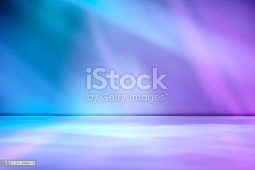 Artistic studio wall background in tones of purple through magenta for product placement or use as a design template