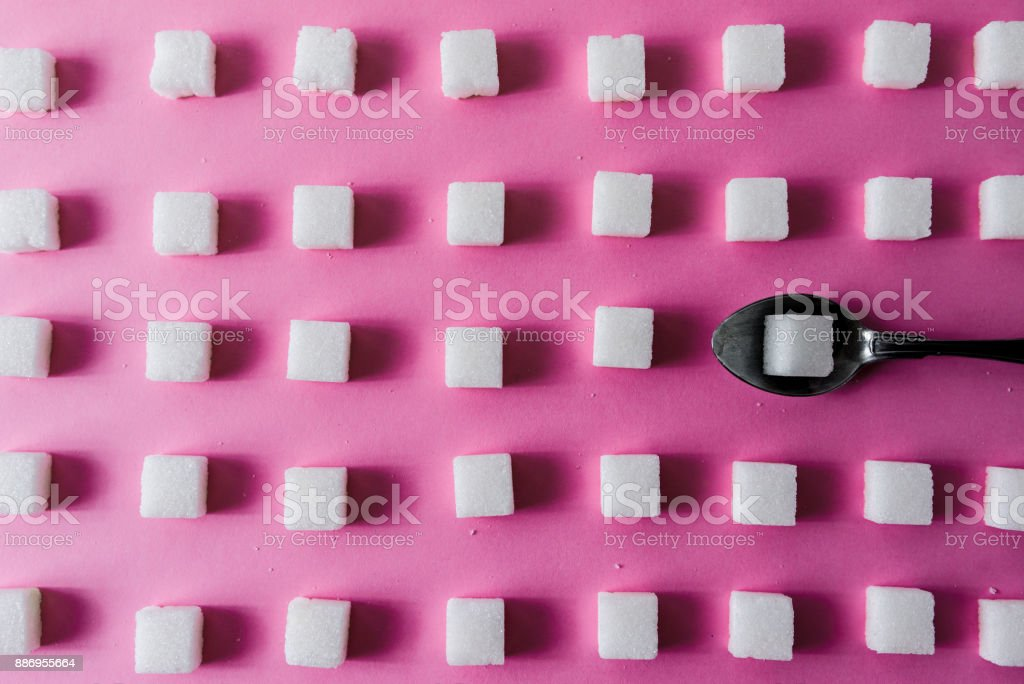 ArtIstic sugar cube pattern on pink background stock photo