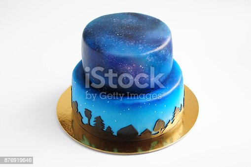 istock Artistic two-tiered cake with the image of the cosmos drawn by airbrush. 876919646