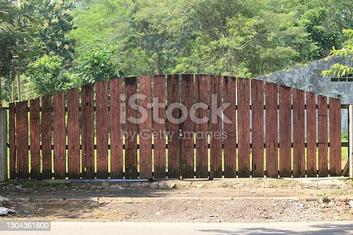 istock artistic wooden gate with an authentic vintage rustic theme. 1304361600