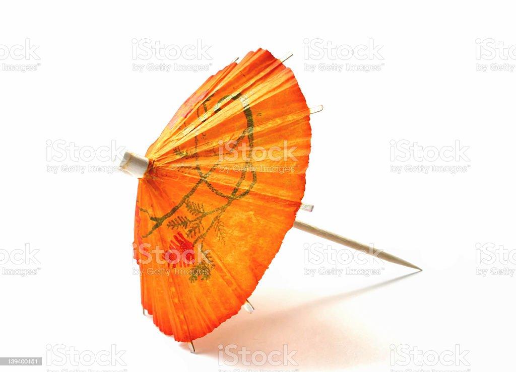 Artistically designed orange cocktail umbrella stock photo
