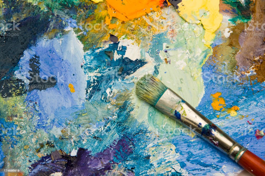 Artists acrylic paint palette close up semi abstract background stock photo